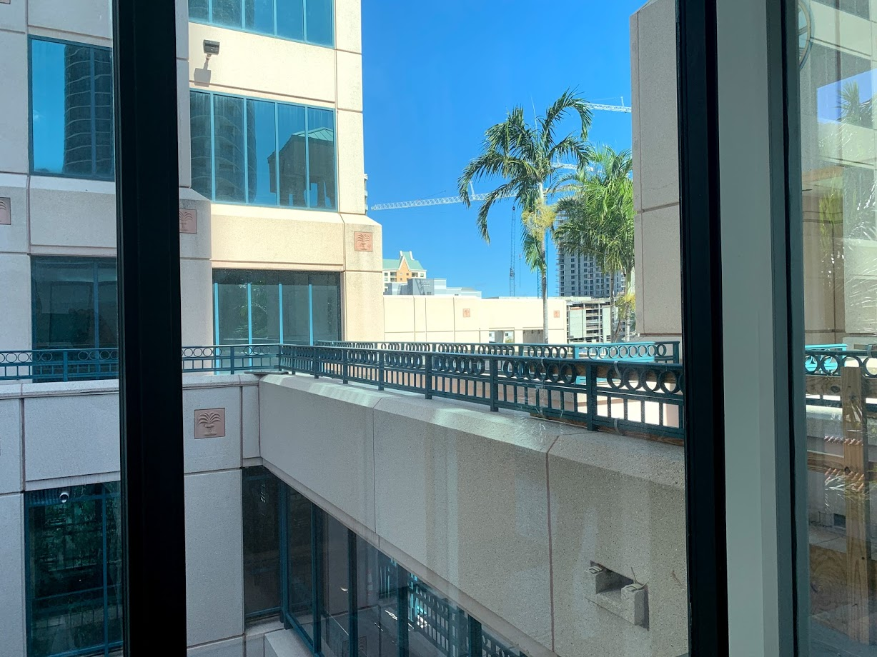 Walkway from Spaces to the main tower of Las Olas Square